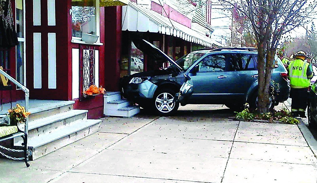 Vehicle crashes into Northville store front