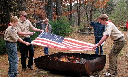 Veterans saluted, flags retired