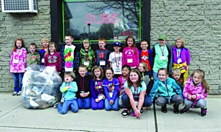 B-P first graders clean up village