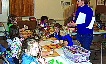 Daisy Troop decorates bags for food pantry