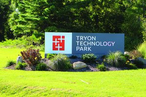 Photo by Levi Pascher The new sign located at the entrance of the Tryon Technology Park is pictured last week. The sign was installed earlier this year and features the positive logo.