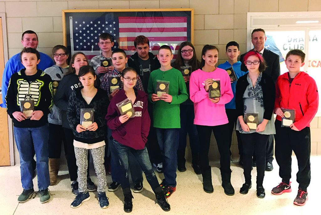 Photo submitted Gloversville Middle School Principal Mark Batty, right, GMS Assistant Principal Christopher DePaolo, left, and the Eagle Award winners for the second quarter of 2016-17.
