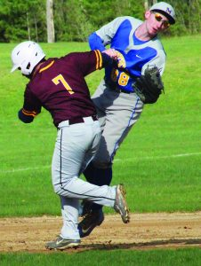 Fonda-Fultonville's Cade Kearns (7) collides with Mayfield's Brian Bentley while running to third base during the game.