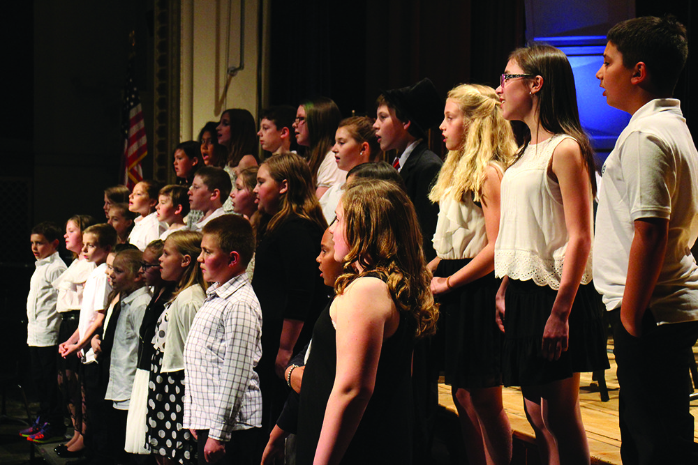 Hundreds of parents, students and faculty gathered Thursday night in the auditorium at Northville Central School for the Music Department's first annual 4th-12th outdoor spring concert. At left, the elementary choir performs under the direction of Kristy Matthews.