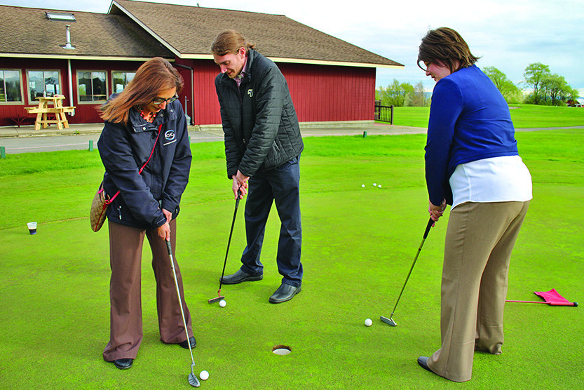 Young Professionals socialize and get some golf tips