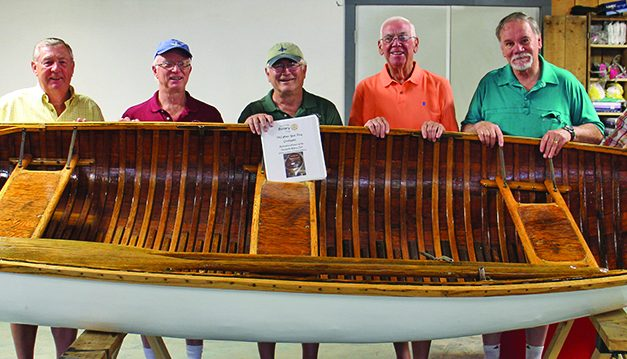 Rotary Club project puts 1952 wooden boat back in the water