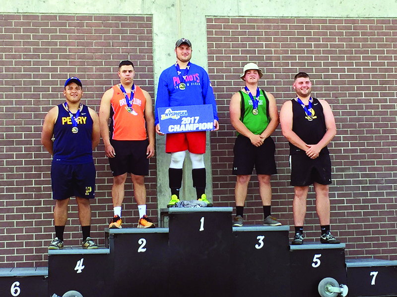 Photo submitted Broadalbin-Perth's Jeff Derwin, center, stands on top of the podium after winning the boys Division 2 discus throw Friday during the NYSPHSAA Track and Field Championships at Union-Endicott High School. Canajoharie's Mike Hartlieb, farthest right, finished fifth. From left, Perry's Edwin Rojo-Altaminrao, Briarcliff's Jack Zimmerman, Derwin, Pembroke's Killian Lewis and Hartlieb.