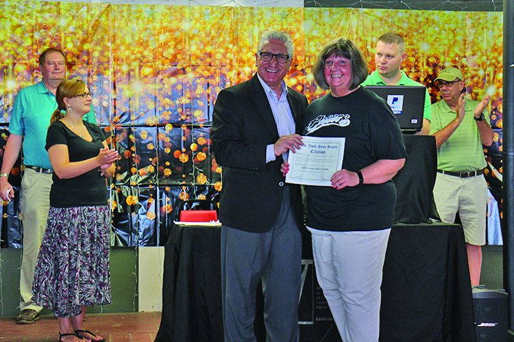Dusten Rader/Express Editor Sen. Jim Tedisco, left, presents Andrea Fettinger, director of the Fulton County Office for Aging, with a citation marking the 30th annual Senior Picnic.