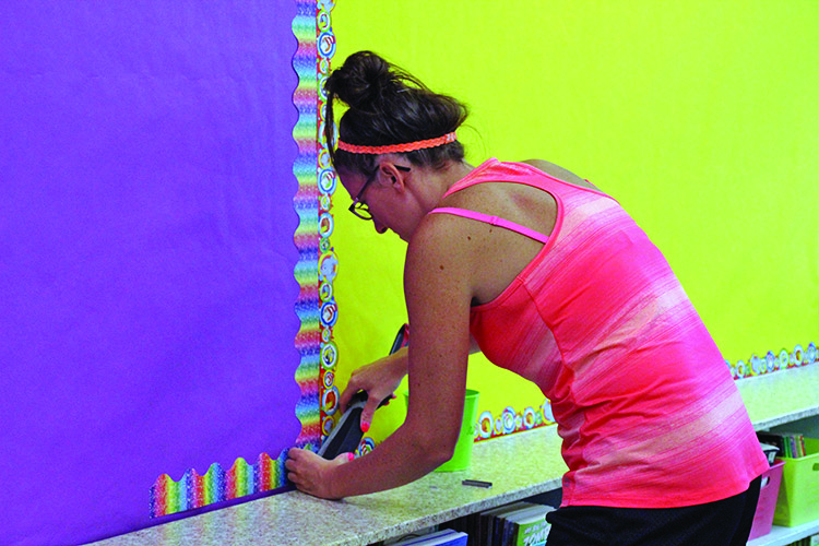 Photo submitted Fourth-grade teacher Brittany Fitsik prepares her room at Boulevard Elementary School ahead of the new school year.