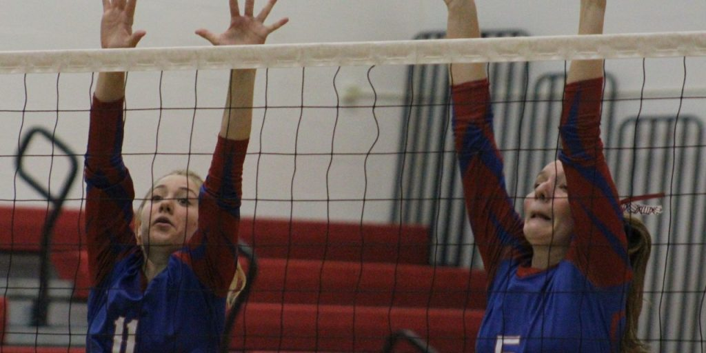 Adam Shinder Broadalbin-Perth's Adrienne Morreale (11) and Cassy Bown (5) go up to block during the Oct. 3 match against Amsterdam at Broadalbin-Perth High School.